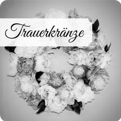 Wunderschöne Trauerkränze und Grabgestecke mit Schleife