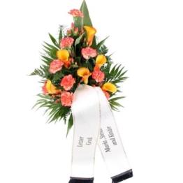 Premium-Trauerstrauß Orange mit Calla und Nelken mit Tauerschleife / Grabschleife