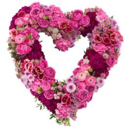 Pinkes Herz-Trauergesteck (mit Eustoma, Rosen)